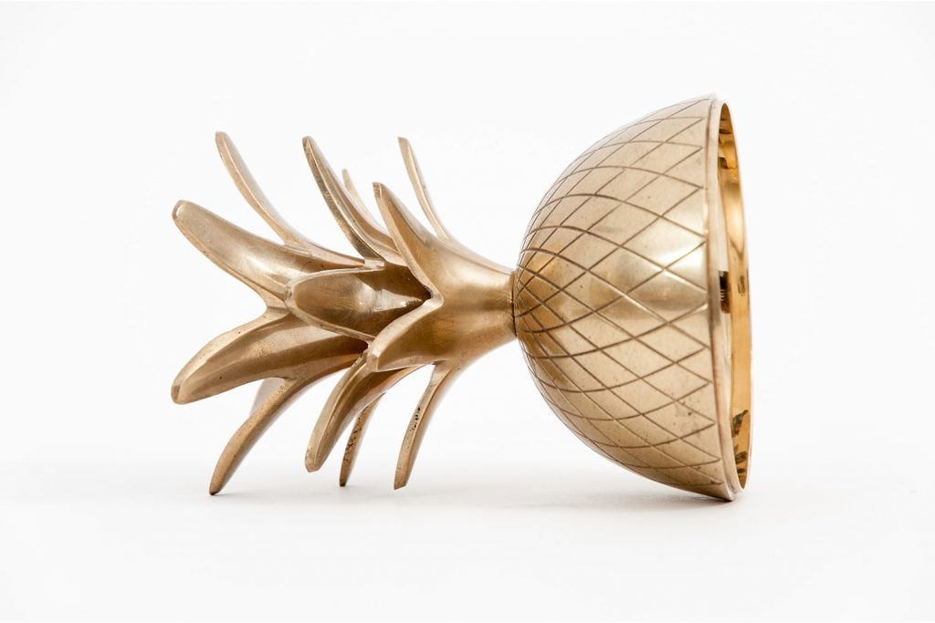 A gold pineapple showcasing user experience