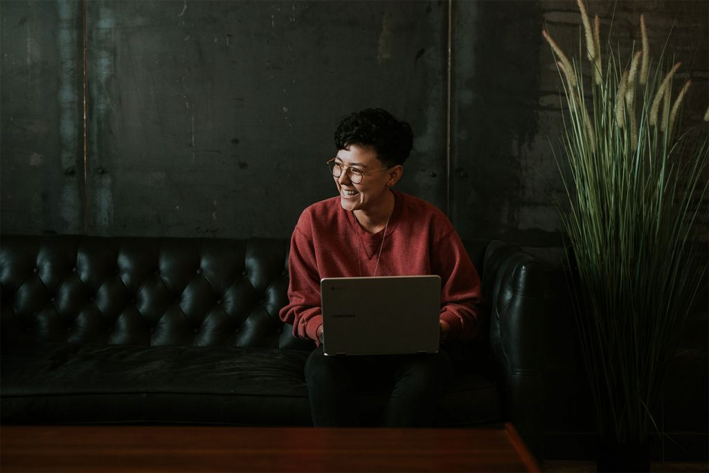 A woman in Portland on a computer